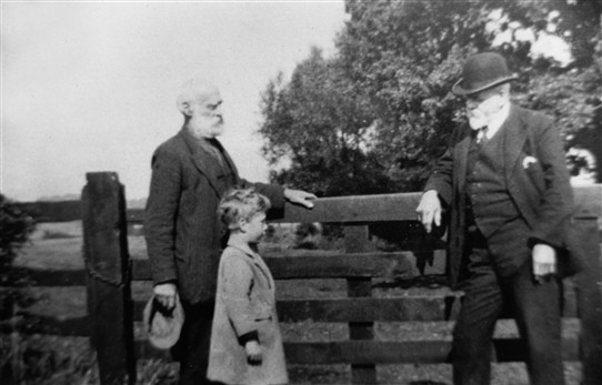 "Photo:Wm Atkinson (left), Ben Atkinson (grandson), Rev. Jennings (right). Photo was taken in 1926 at ""Sweetups"" Church End."