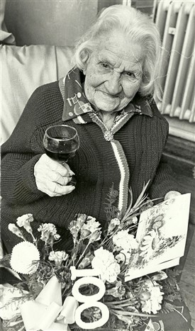 Photo:Susan Sims of Paglesham 100th birthday party. Her maiden name was Nunn and in 1911 she lived at 5 Slate Cottages with husband Ernest and 4 children. The Victor mentioned in the article was her son. She died a few months later in June 1978.